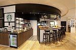 """We Proudly Serve"" Starbucks coffee corner"